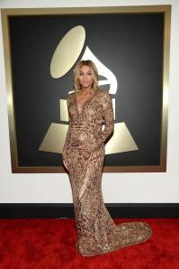 Ciara in a customize  golden Emilio Pucci dress