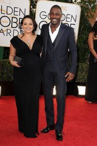 Idris Elba dressed by Gucci with his girlfriend