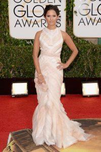 ET's host Rocsi Diaz in a J.Mendel gown