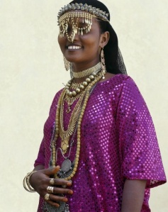 An Afar girl from the Sultanate of Tadjoura wears exotic gold jewellery for marriage and other important celebrations.  Photographer Nigel Pavitt, © John Warburton-Lee