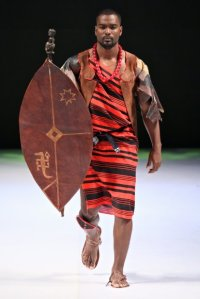 This is for the ladies- A model wearing Gabriel Mollels designs and hold a shield