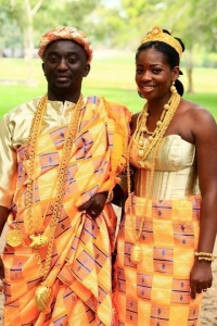 Bride and Groom at their Traditional wedding wearing the Kente and traditional royal jewelry