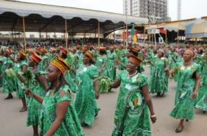 Women marching during Women's Day wearing Kabba